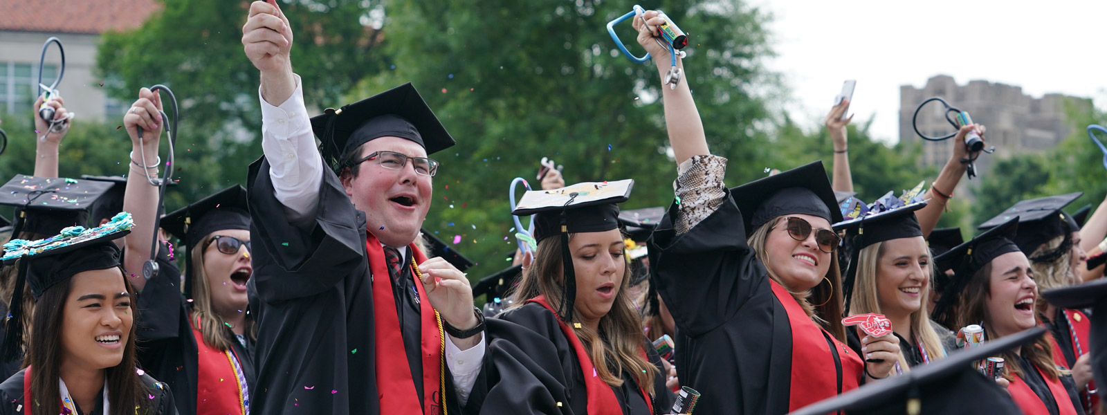 Graduates celebrating at Commencement ceremony