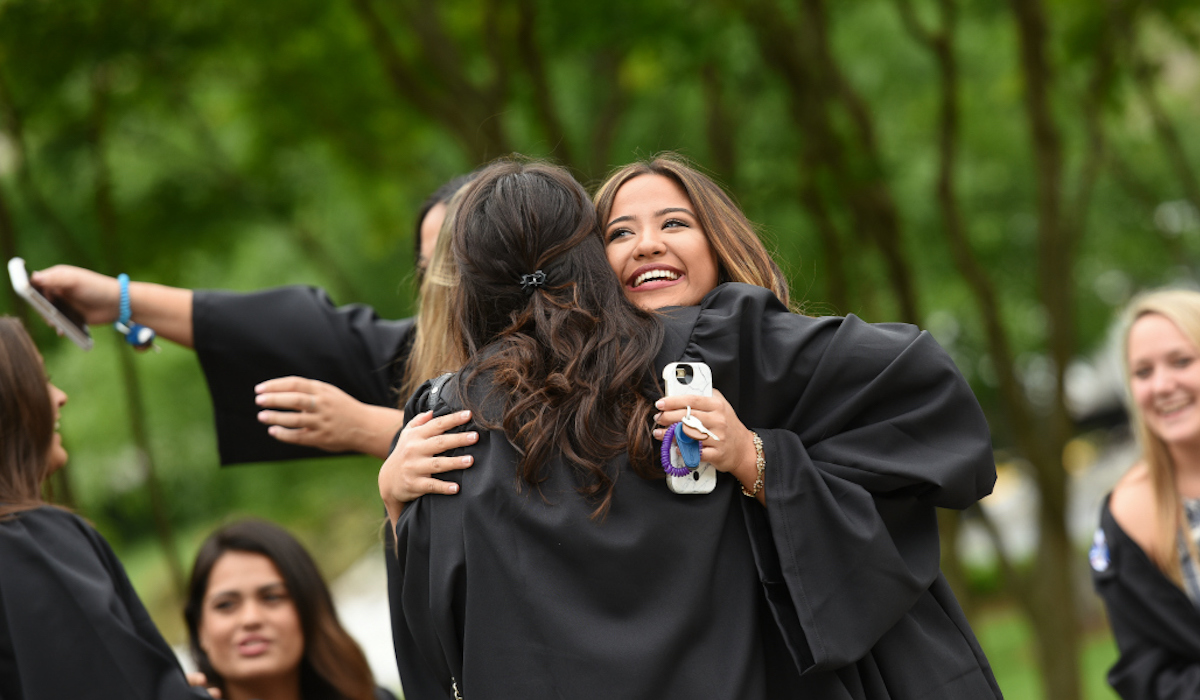 Friends hugging at Commencement